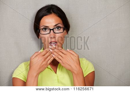 Surprise Lady With Glasses And Hands To Mouth