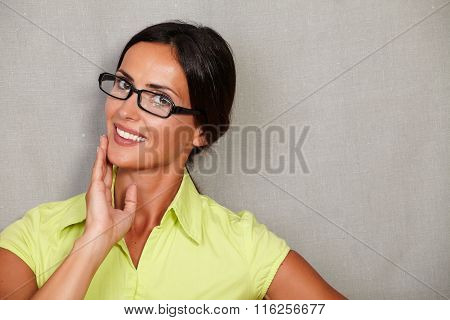 Happy Woman Smiling With Hand On Chin