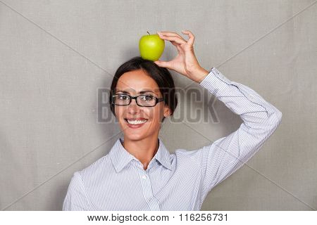 Young Businesswoman Holding Apple On Head