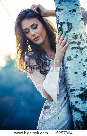 elegant young woman in white dress outdoor shot winter day