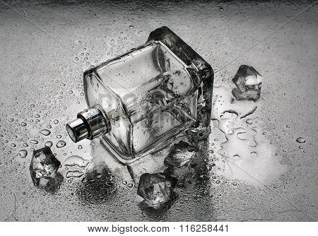 Perfume Bottle On Water