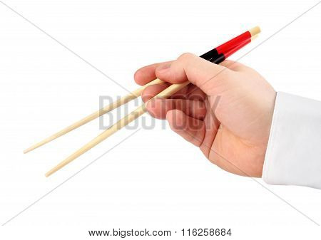 hand holding chopsticks isolated