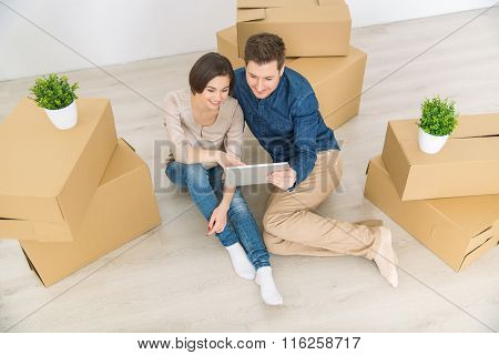 Loving couple holding tablet