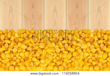 Yellow Corn Grain On Wooden Table Background