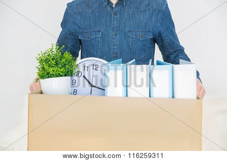 Pleasant man holding the box