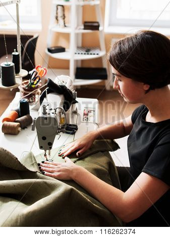 Seamstress Making Clothes. Workplace Of  Tailor