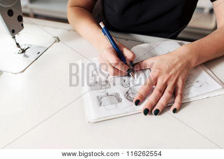 Seamstress Creates A Sketch Of Bags