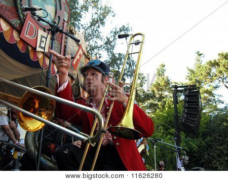 Horn Player Of Mucca Pazza Points Across The Stage During Performance