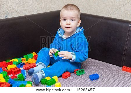 Little Boy Playing In The Constructor On The Couch