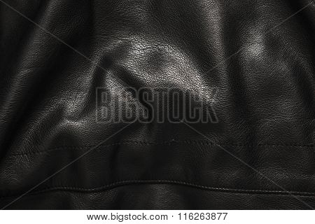 Black Leather Background In The Folds