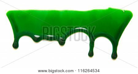 Drops Of Green Paint On A White Background