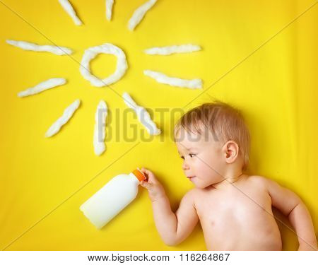 little boy with sunglasses and sun shape