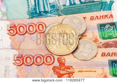Russian And American Coins Over Banknotes Close Up