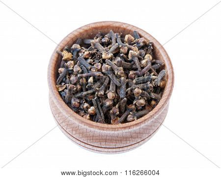 Cloves In A Wooden Bowl Isolate On A White Background