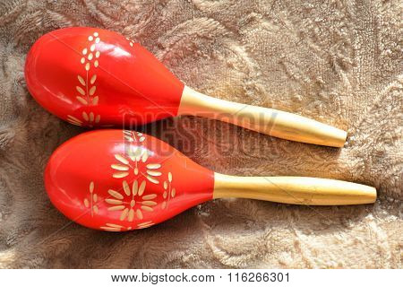 Couple of bright red wooden maracas