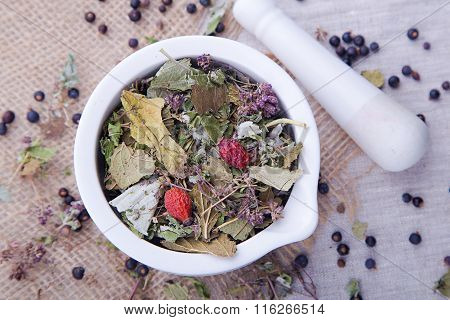 Herbal tea with blackberry in the white mortar