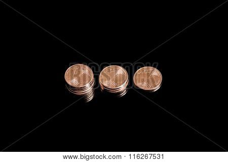 Three shrinking stacks of euro cent coins close-up