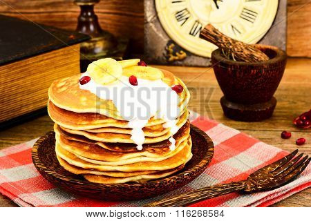 Pancake with Banana, Pomegranate and Sour Cream