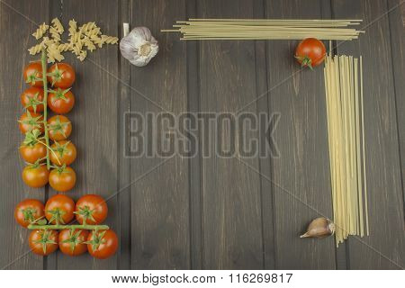 Preparation menu. Pasta and vegetables on a wooden table. Dietary food. Pasta, tomatoes, onion, oliv