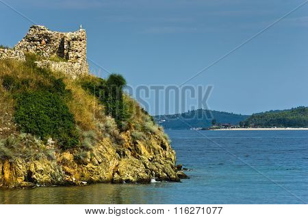 Ruins of old roman fortress with sandy beach in background, Sithonia, Greece
