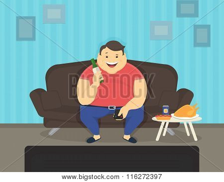 Fat man sitting at home on the sofa watching tv and drinking beer