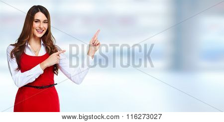 Beautiful business woman presenting copy space.