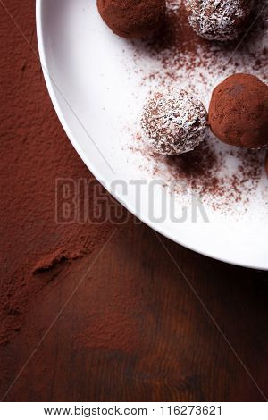 Chocolate sweets with cocoa and coconut chips