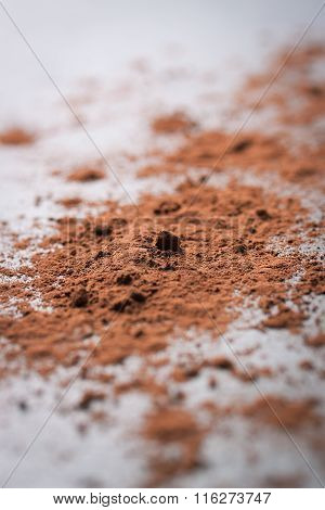 Cocoa powder on a black stone background with copy space