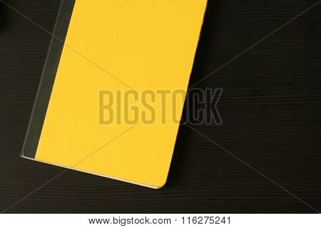 Yellow Diary (notepad) On The Black Wooden Table