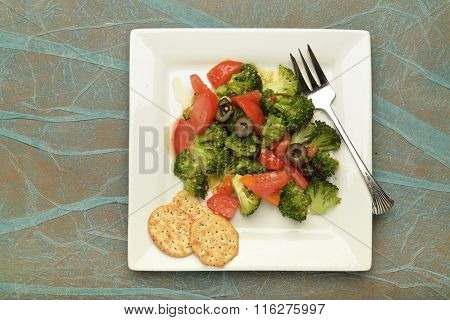 Fresh salad on white plate.