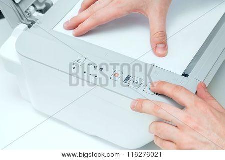 Man puts start button on scanner panel