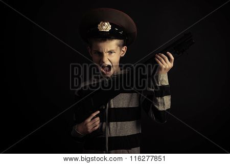 Screaming Boy With Police Hat Holding Rifle