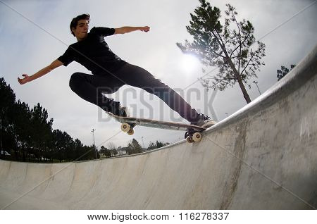 Skateboarder Doing A Tail Slide
