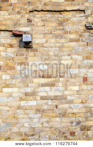stones at the wall of Qutub Minar Tower the tallest brick minaret in the world Delhi India.
