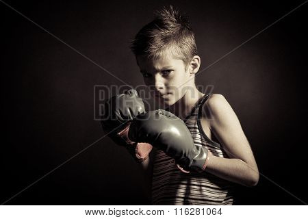 Boxer Boy With Gloves Frowning At The Camera