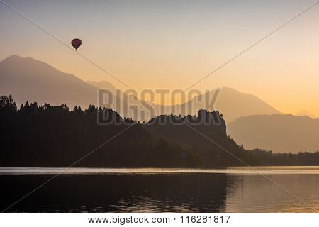 Silhouette Of Bled Castle On A Lake