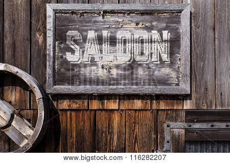 Wooden Sign With Word Saloon