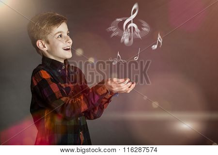 Musical Notes Over The Hands Of A Happy Boy