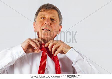 Business Man Binding His Tie