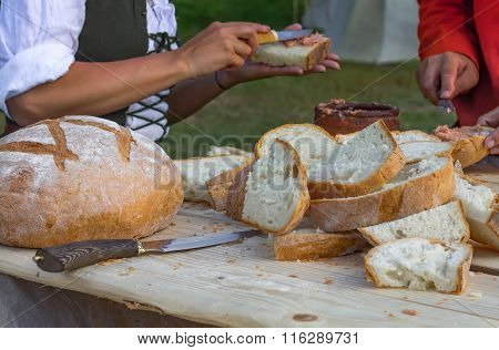 People Put Pate On Bread. Defocused