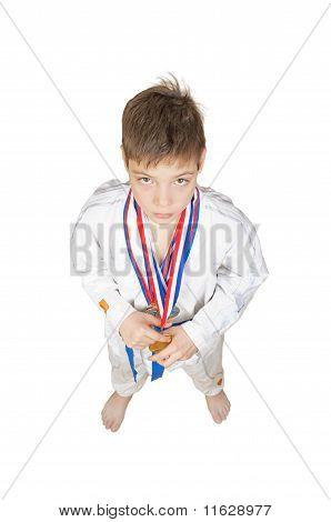 Teenage Boy Wearing Winning Medal