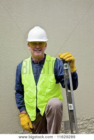 Construction worker with spirit level ready for work