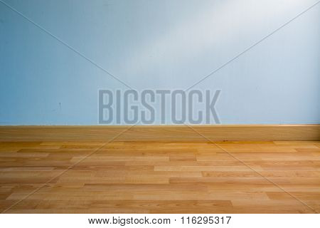 Wood Floor And Light Blue Wall