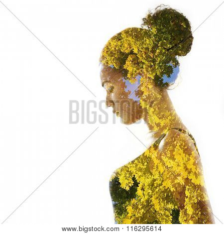 Double exposure portrait of beautiful woman. Beauty portrait of young mulatto woman in profile with autumn tree over white.