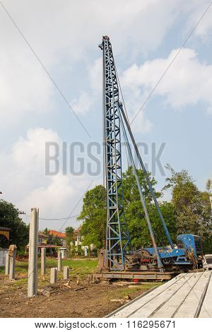 blue metal pile driver at construction site