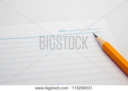 White Paper Note And Yellow Pencil