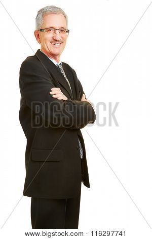 Smiling old businessman with his arms crossed