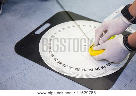 Hand hold Compass And Measure Distance