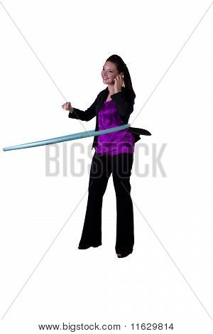 A Happy Businesswoman Exercising With A Hula- Hoop
