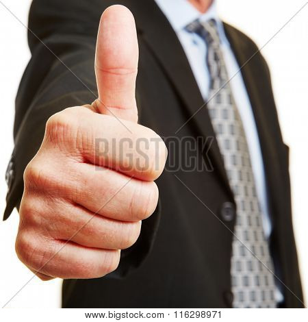Businessman holding thumb up as concept for recommendation and victory